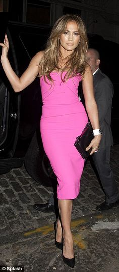 Pretty hot in pink: The star put her famous curves on full display in a skin tight knee-le...