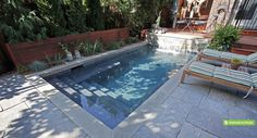 compact plunge pool tucks neatly behind the house in this urban Toronto yard.  The natural pond-look of the dark grey Armorcoat interior offers a pleasing contrast to the Wiarton flagstone coping and deck. (9 x 18, rectangular)
