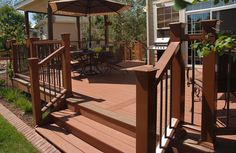 Large deck off back of home with gazebo sitting area