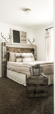 Rustic farmhouse bedroom DIY headboard and oh so bobo bedding from Beddy's Related posts: 60 Smart And Cheap DIY Headboard Ideas Next Level Your Bedroom Design Home Bedroom, Bedroom Furniture, Bedroom Ideas, Master Bedroom, Bedroom Red, Warm Bedroom, Rustic Headboard Diy, Farmhouse Headboards, Barn Wood Headboard