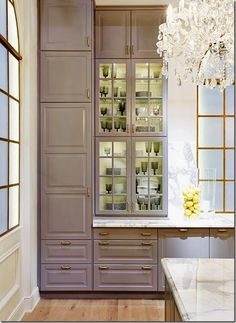 Ikea Lidingo cabinets (from home show in Canada); warm grey, brass hardware, shown with what looks like marble countertops. Gorgeous!! I even have a chandelier that goes!