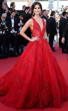 2017 Cannes: Sara Sampaio is wearing a red Zuhair Murad ball gown with a deep v neckline and intricate beading. Hollywood Glamour Queen! This gown is stunning! I love this look from head to toe!