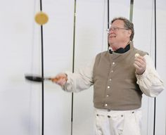 Ralph Naveau successfully flips a pancake in one hand, while holding a coin in the other. Pancake tossing was among the amusements that French Town's settlers enjoyed in mid-winter during the early 1800s in Monroe. (Photo by VANESSA RAY)