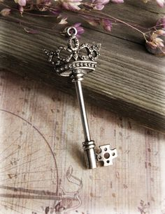 "3"" Key with Crown Top $3.99 each / 6 for $2.99 each     3"" x 1.25""   top screws off to allow you to add beads to the stem if you want."