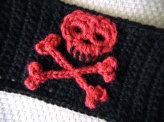 "My co-worker asked me if I could make her a skull and crossbones cuff, and of course I said, ""Sure, why not?"" I'd never made a skull before, so I thought it would be a fun little challenge. This mo..."