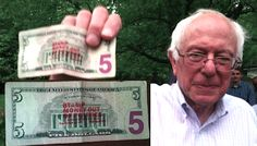 "Bernie Sanders holds up a StampStampede.org bill that says, ""Stamp Money out of Politics!"""
