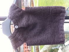 """Just finished this baby vest size 6-12 months. Wool is blend of 55% lambswool and 45% cotton. Pattern is from the book """"All You Knit is Love"""" by Susie Haumann (in Danish)."""