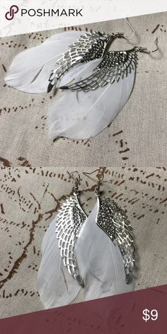 "NEW! Angel wings and feather earrings NWOT. Lovely little white feathers accented with silver angel wing charm earrings. Measures 4"" long. Jewelry Earrings"