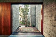 Sebastian Mariscal Studio Cardiff-by-the-Sea, California  The fine grain of Douglas fir formwork adds texture to concrete walls, which continue on the inside of the main entry from the outside.