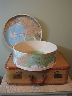 creative storage- vintage suitcase from an antique mall in Lake Park, GA and a wooden cheese box that I painted and mod-podged with pages from a world atlas.