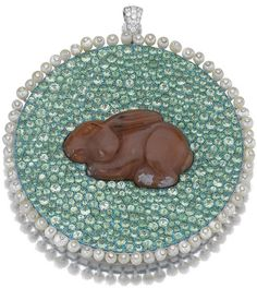 SEED PEARL, TSAVORITE, AGATE AND DIAMOND PENDANT 'RABBIT IN MEADOW', MICHELE DELLA VALLE Of circular form, the carved agate rabbit to a ground pavé-set with circular-cut tsavorite garnets, the border set with seed pearls studded with brilliant-cut diamonds, mounted in white gold and titanium, signed Michele della Valle and numbered, inscribed to the reverse Liao Dynasty A.D. 907-1125, fitted case. 49 Rabbit Rabbit Rabbit, Some Bunny Loves You, Pearl Studs, White Stone, Animal Jewelry, Diamond Pendant, Art Deco, Carving, Jewels