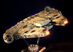 """1/72 scale Star Wars 'Millennium Falcon' - John Simmons, West Mersea, Colchester, Essex, England. John writes: """"Here's my 1/72 scale FineMolds Millennium Falcon. I tried to stay as faithful to the 32"""" studio model as I could, trying to replicate every stain, scratch, blast mark, etc. The model is lit by 17 LEDs, and the cockpit has fiberoptics — even C-3PO's eyes!"""""""