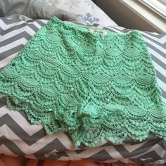 High-Waisted Lace Crochet Shorts Up for sale is a never worn pair of seafoam green crochet shorts from Charlotte Russe! They have a high rise and a zipper on the side. There are no flaws, stains, rips, or snags. Absolutely perfect condition. The color is gorgeous and these shorts would make for a great day going out or even transformed into a nighttime outfit with wedges! Charlotte Russe Shorts