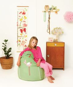 New for the Early Bird, Green pinwale cord bean bag with sweet pink applique.