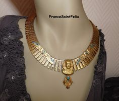 Gold EGYPTIAN blue turquoise beads Egypt NECKLACE Tut Pharaoh cut strips of gold metal and carved OOAK costume jewelry boutique. $99.00, via Etsy.