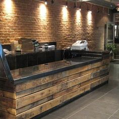 Look: Creative Uses for Recycled Shipping Pallets DIY Store counter. Made from pallets. Thinking maybe an old bar could be lined with the old wood, then add a counter top?MY basement bar one day! Bar Pallet, Pallet Counter, Pallet Ideas, Pallet Projects, Pallet Island, Outdoor Pallet, Outdoor Sheds, Easy Projects, Deco Restaurant