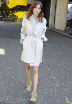 Alexa Chung arrives to the Vogue Festival in a belted topper and booties. London