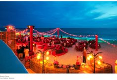 red beach wedding reception decor. Photo by Colin Miller Photography
