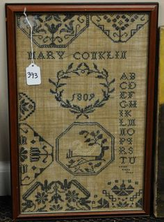 Small Quaker sampler - featuring a white swan and full alphabet.