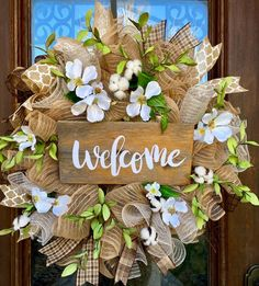Welcome mesh wreath for spring/summer loaded with dogwood flowers and cotton bolls.  www.facebook.com/southernsass