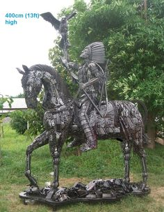 Native American on Horseback, with Hawk sculpture, life-size scrap metal art - photo by scrap-metal-art-thailand