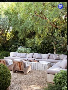 How inviting does this outdoor seating look? Love the modern fire pit and seating surrounded by lush green. The gravel hardscape not only provides a no-water area, but also allows rain water to permeate into the ground. Outdoor Fire, Outdoor Seating, Outdoor Rooms, Outdoor Gardens, Outdoor Living, Outdoor Decor, Outdoor Sectional, Outdoor Lounge, Outdoor Cushions