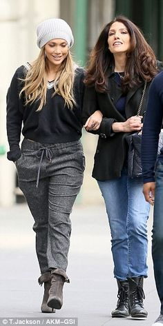 Casual Sunday: Jennifer wore drawstring charcoal pants tucked into ankle boots, a v-neck s...