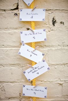 Miniature clothespins were used to attach the escort cards to yellow ribbons. Photo: Vantage Pictures.