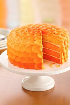 Tangerine Ombre Cake -- great for a birthday party or a halloween party. Easy recipe and tons of fun to make!