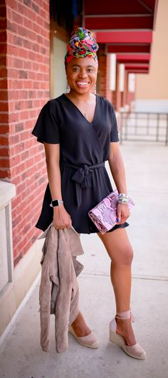 1 of 3 ways to style a dressy romper. Fashionista and style blogger shows us how to dress up an affordable romper for a night out or dinner date. Pair this classy faux wrap romper with snap closure with a gorgeous pair of tie-up affordable espadrille wedges. Add on a buttery soft moto jacket to stay warm, a leather purse, and a head wrap with lots of colors. #datenight #datenightoutfit #blackoutfit