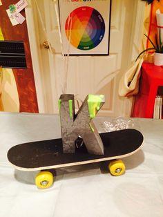 Centerpiece... metal oozing letter K (ooze puff paint in neon green) (Mini skateboard 5 Below) Add 11' Ninja Turtle  and cluster of balloons. Tada!