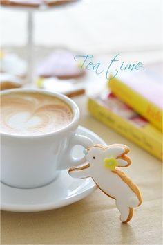 white bunny cookie w/ coffee