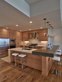 Contemporary Kitchen with Corian counters, European Cabinets, Flush, Moda Horizontal Cabinet Door, Limestone, U-shaped