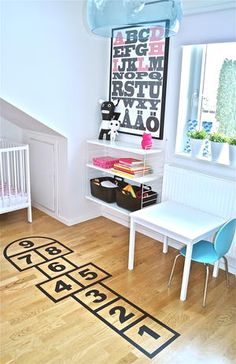 Adding a hopscotch decal to the floor is a great idea for a kids room or even an indoor play space.