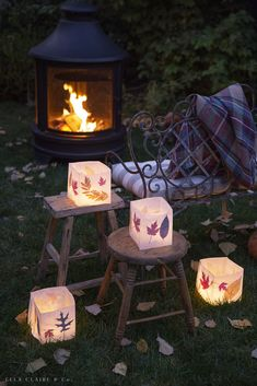 Make these easy luminaries with real Autumn leaves! Use them for entertaining, decorating, parties, weddings, to light up a pathway or like this magical evening outdoors with a fire pit and fall leaf luminaries.