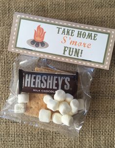 Keep your camping/western party going with these build a smore party favor tags! This listing is for 4 camping themed bag toppers. Once you purchase, a instant PDF file will be sent to you. Simply print on card stock, cut them out and fold. In a plastic or cellophane bag, place marshmallows, a chocolate bar and graham crackers. Super cute and a fun way to thank your guests! INCLUDES:  One page printable PDF with four bag toppers that say Take Home Smore Fun! Print as many as you would like…