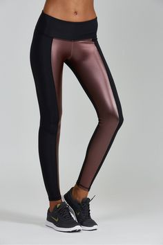- Color: Vino - Mid rise. - Ankle length legging. - Contrast panel on inner part of leg. - Moisture wicking. - Quick dry fabric. - Flatlock seams for extra comfort. 88% Nylon 12% Spandex. Model is 5'9