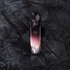Prima Noir Eau de Parfum. Strong. Mysterious. Graceful. Prima Noir is inspired by the strength and alluring mystique of a prima ballerina with a bold enigmatic edge. This nighttime scent is an indulgent expression of warm, feminine notes for the woman who isn't afraid to let her hair down. Fun and playful yet always graceful, she knows when the sun goes down, it's her time to shine.