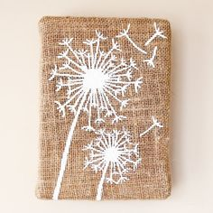 You can create your own Dandelion Burlap Art for under $5.00. Plus this little project has a recycling secret!