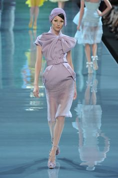 Christian Dior Spring 2012: woman's 1930 inspired hat with curved flaps.