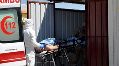 A suspected chemical attack in a rebel-held Syrian town killed 100 people and injured 400 others, a medical relief group said, and some medics treating the wounded were later struck by rubble when an aircraft reportedly bombed a hospital.