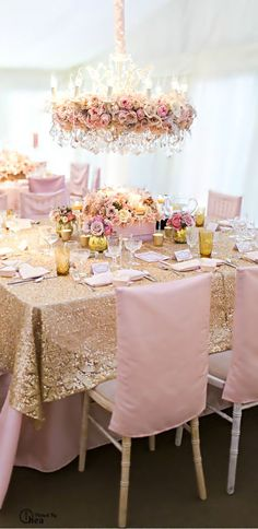 gold sequin table overlays (will be over ivory) but this would look good with peach/coral napkins!