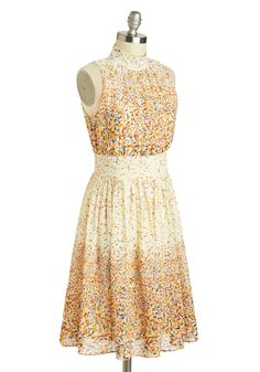 Birthday Party:  This dress is like your very own colorful ticker tape parade, making you the center of the celebration on your special day.  And with that beautiful breezy skirt, you'll feel like you're floating on air while you tear open your mountains of presents.  Pair this with some dangly earrings and your colorful heel of choice.