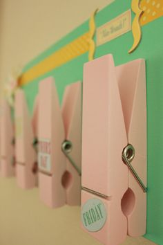 Fun way to organize for school (easy diy)... would make for a cute menu in the kitchen for the week. clip a different recipe to each clip.