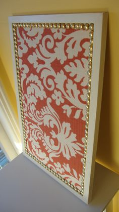 Cork bulletin board covered in fabric