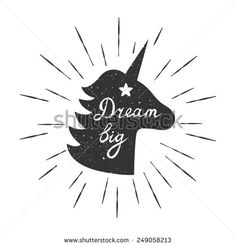"Vector motivation card with unicorn silhouette, sunbursts, and text ""Dream big"". Stylish vintage background with inspirational words."