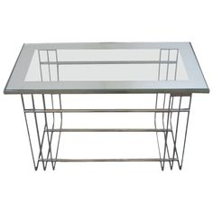 American Art Deco Chrome Cocktail Table in the Style of Donald Deskey: 1930s | From a unique collection of antique and modern coffee and cocktail tables at https://www.1stdibs.com/furniture/tables/coffee-tables-cocktail-tables/