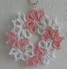 Five petal unclosed flowers 8 repeats to form round medallion
