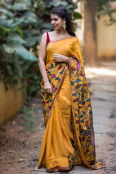 We can never get enough of Kalamkari patch works. This mustard pure crepe beauty is an ode to our love. The brocade red border adds a touch of bling to the otherwise simple ethnic saree. The picturesque kalamkari patchwork that works a story on its own takes the saree to a different level of sophistication. Complement her with a red velvet blouse and you are sorted.ACCOMPANIMENTS: All sarees are sold completely finished with falls (where required) and a free size underskirt.  FABRIC: Saree…