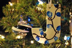 Homemade Christmas ornament - let each kid paint a small wooden letter for initial-- link not necessary as gives no direction, but pic is good reference. Can write on the back name, year, things about them that year, etc